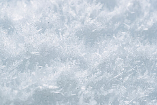 Close up sur des flocons de neige gelés - Arrière plan texturé neige glace