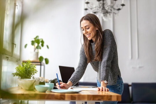Young female freelancer working in loft office