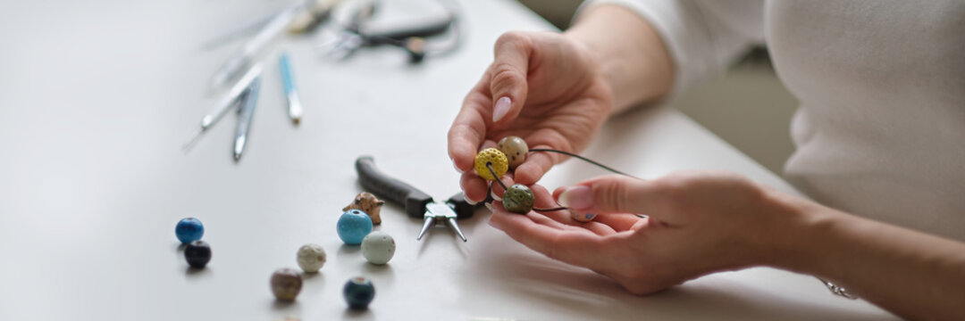Craft jewelery making with professional tools. A handmade jeweler process, manufacture of jewellery.