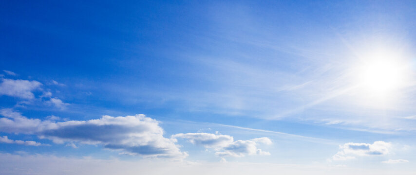 Sky with clouds, sunlight. Panarama of blue sky. Scenery.