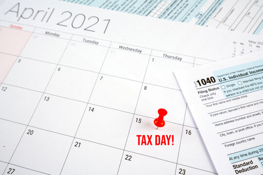 us individual income tax return 1040 form for 2020 with tax day text and red pin on april 15th on april 2021 calendar.