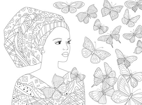 Beautiful african woman looking away at flying butterflies aroun