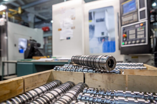 the steel part is large against the background of the cnc machine. Low-depth-of-field photography