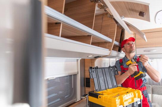 RV Production Line Technician Finishing Cabinets Installation Inside Motorhome