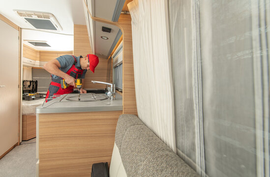 RV Technician Repair Travel Trailer Stove