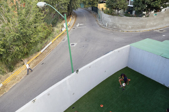 Deportivo Petare Futbol Club's player Yodanyeliz Palacios kicks a ball during a practice at team's sport house in Caracas