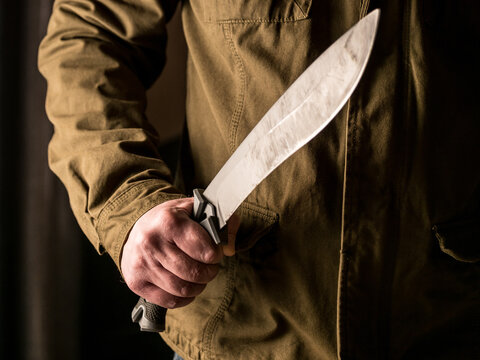 Man holding a machete in his hand