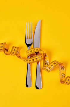 Knife and fork with measuring tape