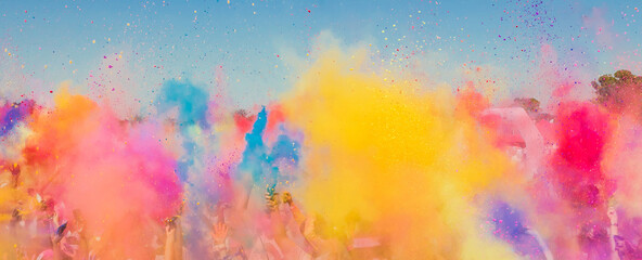 Group of people playing with colorful powder at a festival in South Africa