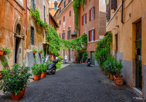 Old street in Trastevere, Rome, Italy. Trastevere is rione of Rome, on west bank of Tiber in Rome. Architecture and landmark of Rome