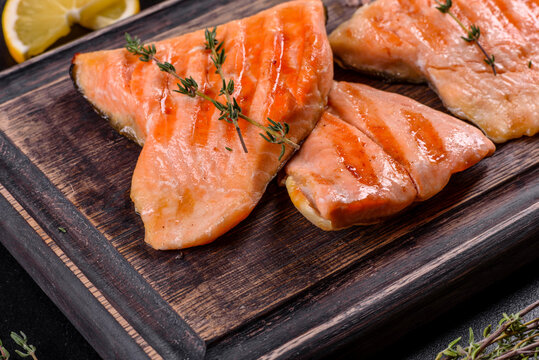 Tasty fresh red fish arctic char baked on a grill