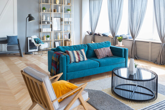 elegant creative modern trendy interior of a spacious open plan Scandinavian style studio with seating and sleeping areas