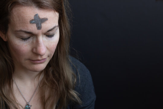 portrait of woman with ash cross on forehead