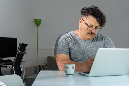 Young man only working after hours. person working on laptop on cowork space.