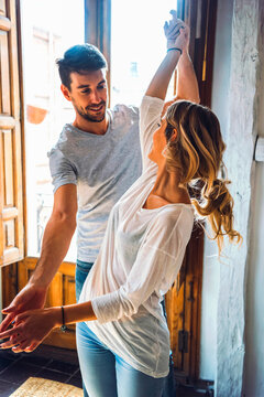 Charming young couple in moment of dancing