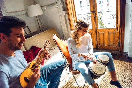 Sweet couple playing music