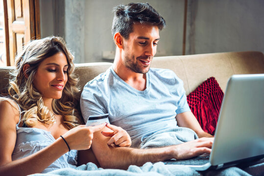 Lovely couple buying in Internet