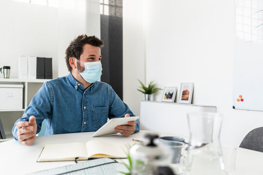 Man wearing protective mask working in office