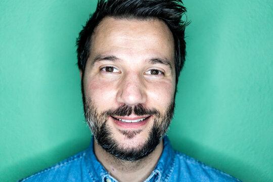 Studio portrait of smiling man