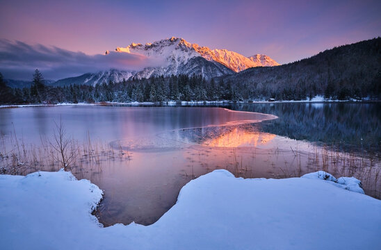Scenic view of Lautersee lake with Karwendel mountain during sunset