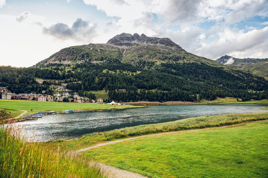 Switzerland, Canton of Grisons, Silvaplana, Shore of Silvaplana Lake with village in background