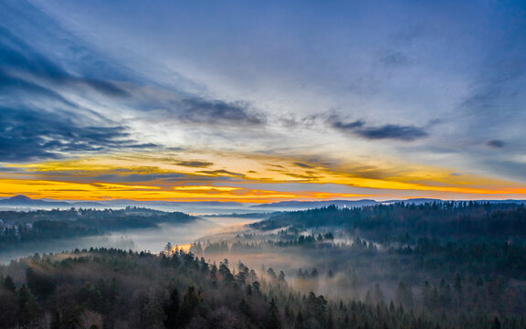 Germany, Baden-Wurttemberg, Drone view of Swabian Forest at foggy dawn