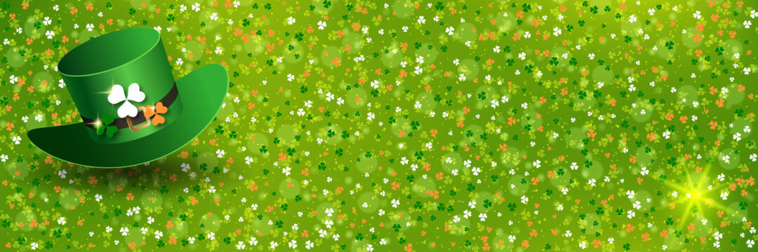 St.Patrick's Day green blurred vector background with colorful clover leaves and leprechaun hat