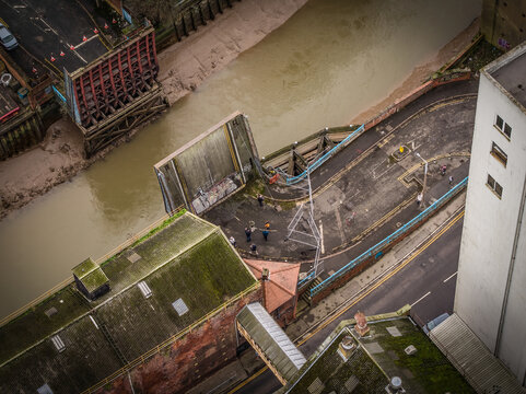 Aerial view of people taking photos at graffiti on a drawbridge along the Humber river in Hull, United Kingdom.