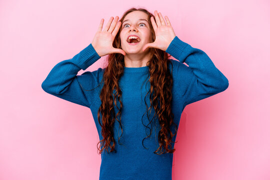 Little caucasian girl isolated on pink background shouting excited to front.