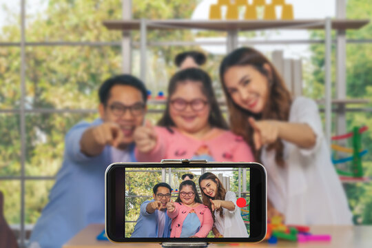 down syndrome teenage girl with family as blogger live broadcast together
