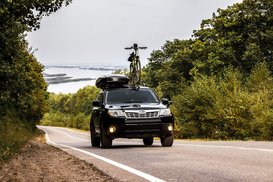 Khabarovsk, Russia - September 07, 2019: Subaru Forester with a bicycle and roof box at roof rack