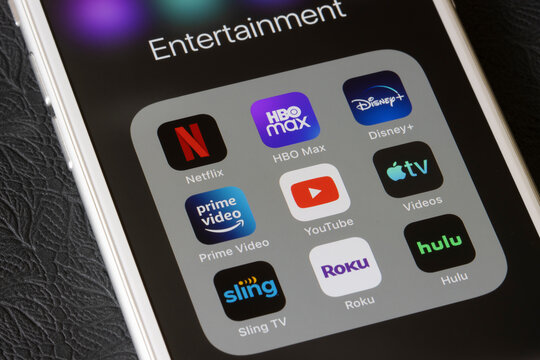 Portland, OR, USA - Feb 2, 2021: Assorted streaming apps are seen on an iPhone, including Netflix, HBO Max, Disney Plus, Amazon Prime Video, YouTube, Apple TV, Sling TV, Roku, and Hulu.