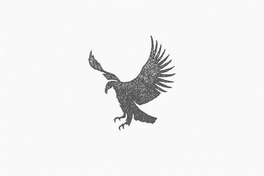 Black silhouette wild eagle soaring in sky in countryside hand drawn stamp effect vector illustration.