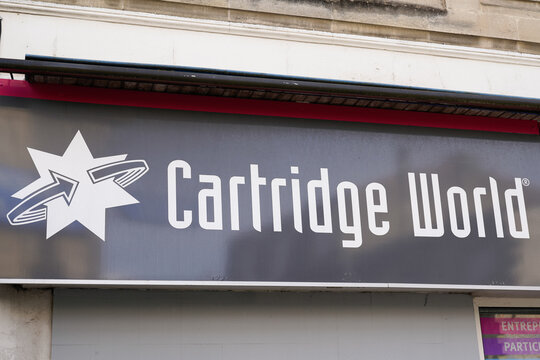 cartridge World logo brand and text sign front of store facades business specializing in managed print services printer solution