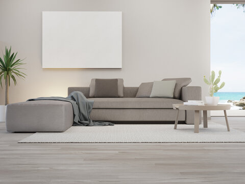 Blank picture frame near sofa on carpet of large living room in modern house or luxury villa. Cozy home interior 3d rendering with beach and sea view.