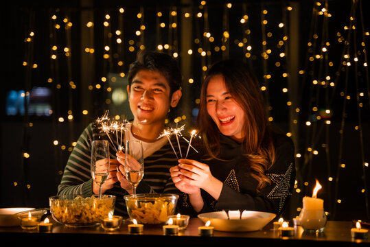 young couple celebrate at night party, romance date and love concept for Valentine's Day, dinner with night candle light, cozy with couple family at home