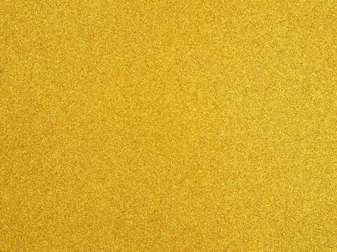 Golden yellow glitter color paper empty background texture for design...