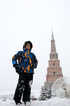 Kid on background of Syuyumbike tower in Kazan Kremlin