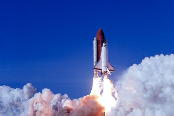 Take off space rocket on a background of blue sky and sun. Elements of this image were furnished by NASA