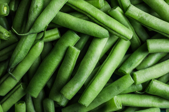 Fresh green beans as background, top view