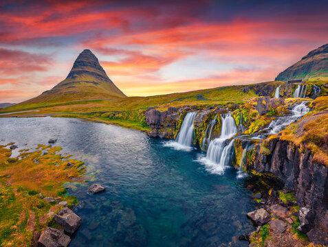 Landscape photography. Amazing morning view of popular tourast destination - Kirkjufellsfoss Waterfall. Colorful sunrise on Snaefellsnes peninsula, Iceland, Europe. Travel to Iceland.
