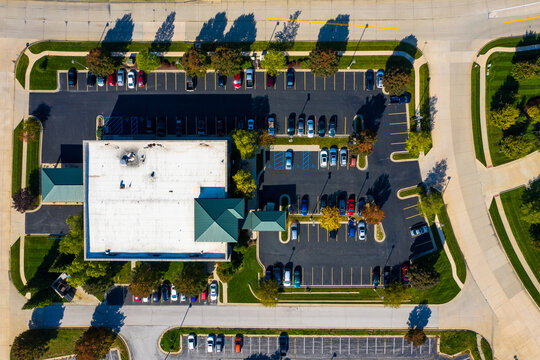 Aerial view of a parking lot busy of vehicles in a small residential park in Columbia, Missouri. United States of America
