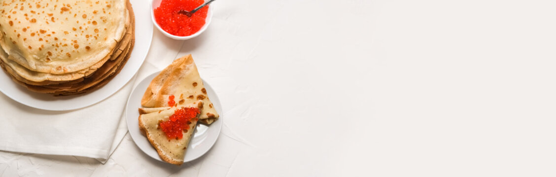 thin pancakes with red caviar on white napkin. The concept of the Russian carnival Maslenitsa. space for text, banner