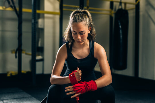 woman preparing for training in gym