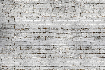 Texture of an old brick wall with peeling white paint