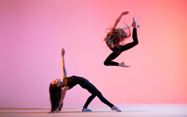 Photo Blinds Dance School two ballet girls with long loose hair in black tight-fitting suits dancing