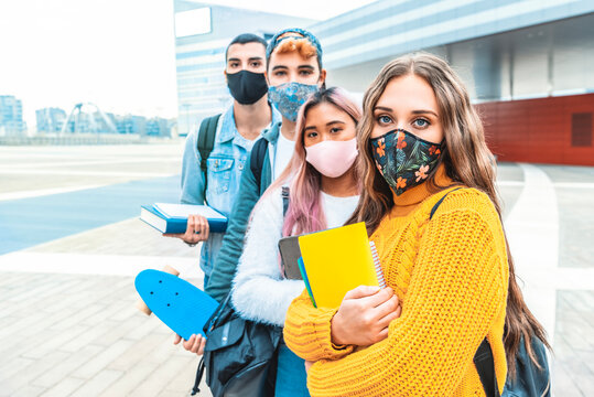 Portrait of a group of students covered by face masks. New normal lifestyle concept with young people going to school at corona virus pandemic.