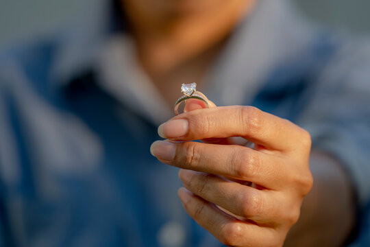 Sad Wife Take off the diamond wedding ring from finger. Quarrel fight of breakup Conflict, bad relationships. Depressed female suffer  Major Depressive Disorder Problem from Dysfunctional Family