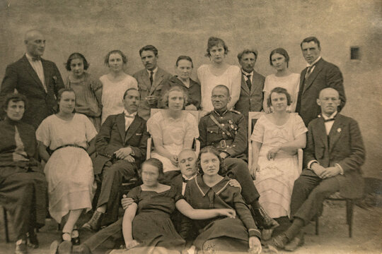 Latvia - CIRCA 1920s: Group photo of party guests. Vintage historical archive photo. Some men in uniform.