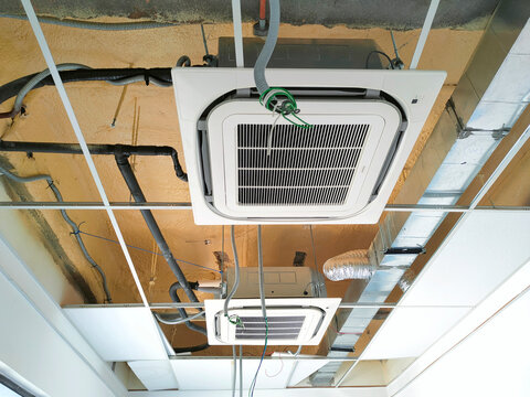 SELANGOR, MALAYSIA -MARCH 2, 2021: Installation of ceiling cassette air-condition. Mounted on the ceiling, and has the ability to cool the space more efficiently.
